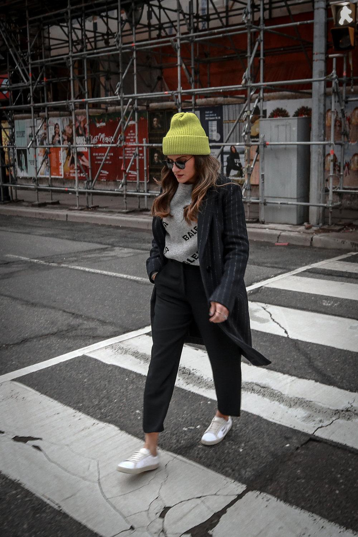 Nathalie Martin wearing Balenciaga cropped logo sweater, Aritzia black Jallade pant, Saint Laurent white canvas court sneakers, Aritzia navy pinstripe Stedman coat, neon green beanie, Bonlook Way sunglasses, street style, woahstyle.com_3869.jpg