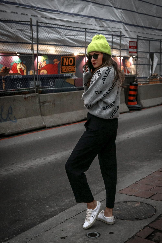 Nathalie Martin wearing Balenciaga cropped logo sweater, Aritzia black Jallade pant, Saint Laurent white canvas court sneakers, Aritzia navy pinstripe Stedman coat, neon green beanie, Bonlook Way sunglasses, street style, woahstyle.com_3918.jpg