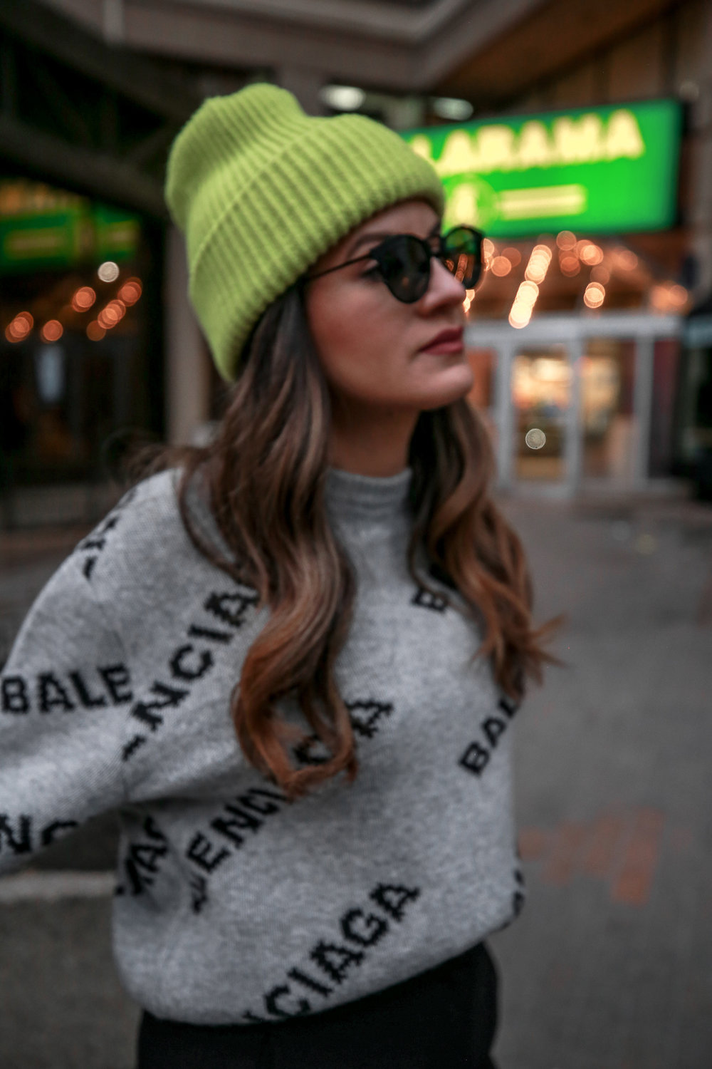 Nathalie Martin wearing Balenciaga cropped logo sweater, Aritzia black Jallade pant, Saint Laurent white canvas court sneakers, Aritzia navy pinstripe Stedman coat, neon green beanie, Bonlook Way sunglasses, street style, woahstyle.com_3935.jpg