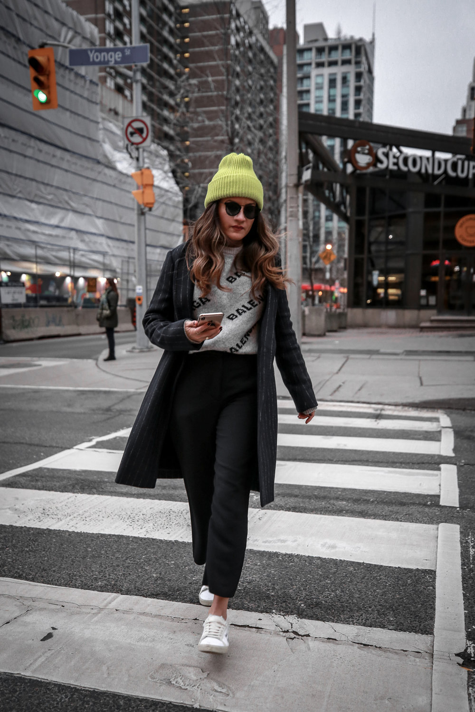 Nathalie Martin wearing Balenciaga cropped logo sweater, Aritzia black Jallade pant, Saint Laurent white canvas court sneakers, Aritzia navy pinstripe Stedman coat, neon green beanie, Bonlook Way sunglasses, street style, woahstyle.com_3964.jpg