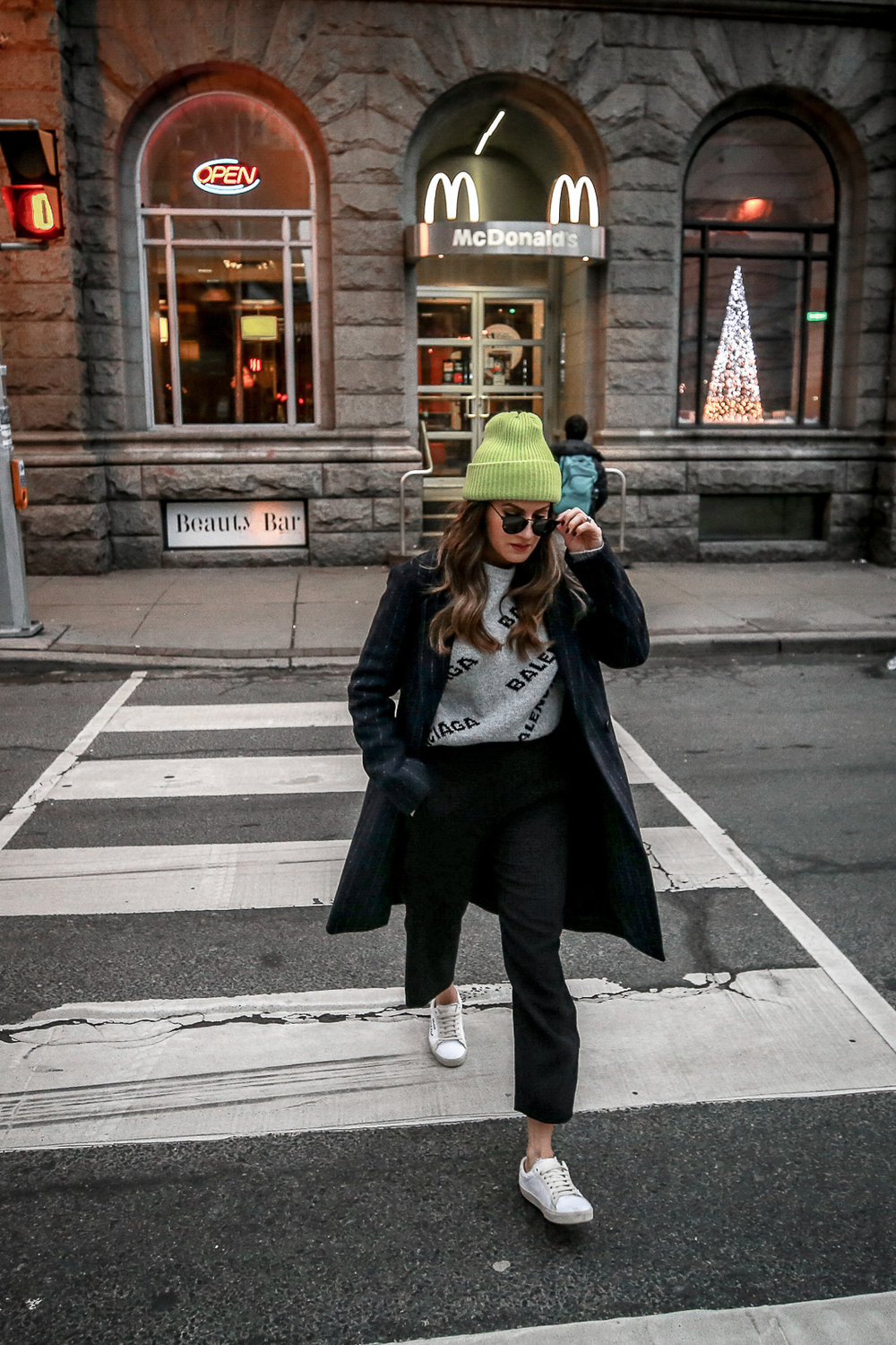 Nathalie Martin wearing Balenciaga cropped logo sweater, Aritzia black Jallade pant, Saint Laurent white canvas court sneakers, Aritzia navy pinstripe Stedman coat, neon green beanie, Bonlook Way sunglasses, street style, woahstyle.com_3907.jpg