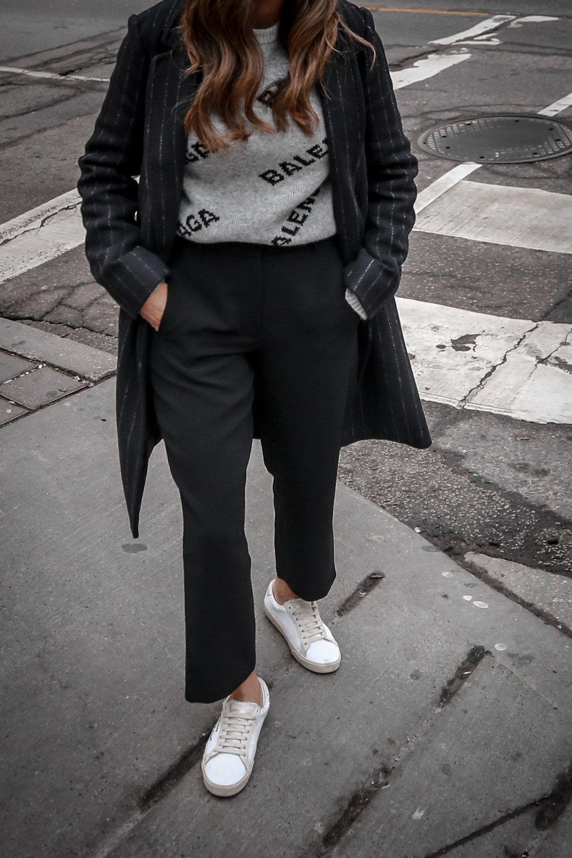 Nathalie Martin wearing Balenciaga cropped logo sweater, Aritzia black Jallade pant, Saint Laurent white canvas court sneakers, Aritzia navy pinstripe Stedman coat, neon green beanie, Bonlook Way sunglasses, street style, woahstyle.com_3856.jpg