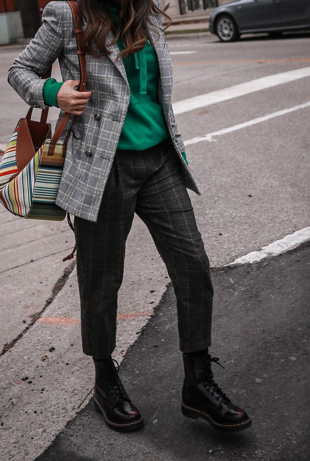 Nathalie Martin wearing plaid blazerk from Zara, green Isabel Marant hoodie, Aritzia wool Chambery pant, Doc Marten boots, striped Loewe hammock bag, Acne Studios ivory Pansy face beanie, woahstyle.com_4709.jpg