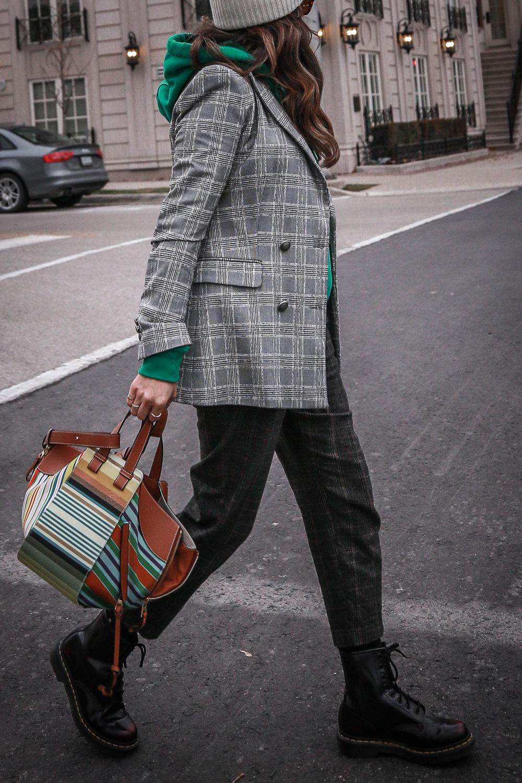 Nathalie Martin wearing plaid blazerk from Zara, green Isabel Marant hoodie, Aritzia wool Chambery pant, Doc Marten boots, striped Loewe hammock bag, Acne Studios ivory Pansy face beanie, woahstyle.com_4720.jpg