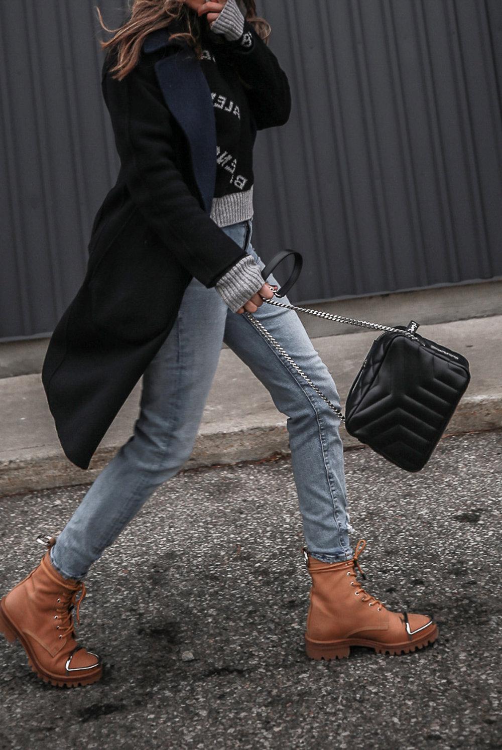Nathalie Martin wearing Balenciaga black logo sweater, GRLFRND Denim Karolina jeans from Revolve, Saint Laurent LouLou small bowling bag, Alexander Wang Lyndon combat boots, Rag & Bone reversible wool coat, street style, woahstyle.com_4639.jpg