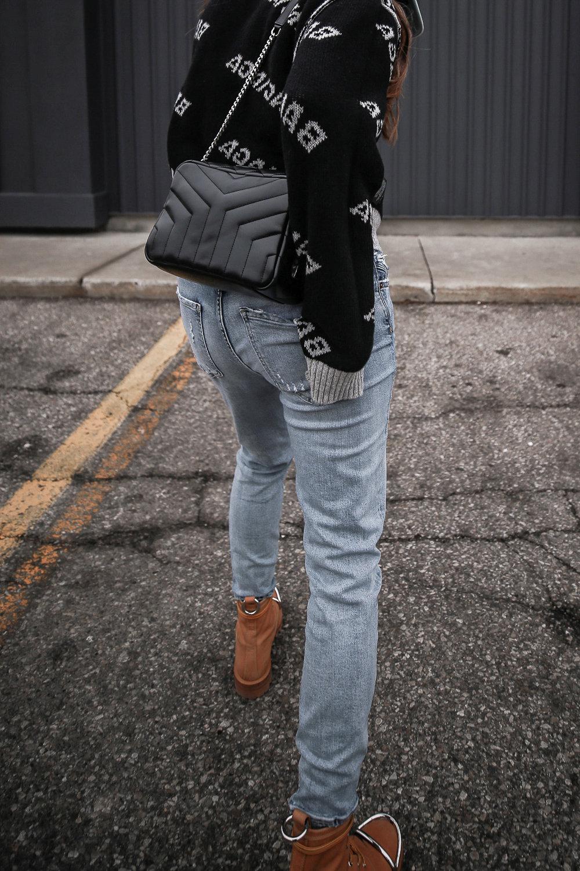 Nathalie Martin wearing Balenciaga black logo sweater, GRLFRND Denim Karolina jeans from Revolve, Saint Laurent LouLou small bowling bag, Alexander Wang Lyndon combat boots, Rag & Bone reversible wool coat, street style, woahstyle.com_4677.jpg