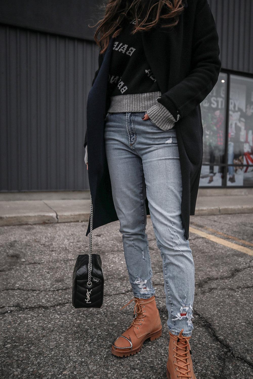 Nathalie Martin wearing Balenciaga black logo sweater, GRLFRND Denim Karolina jeans from Revolve, Saint Laurent LouLou small bowling bag, Alexander Wang Lyndon combat boots, Rag & Bone reversible wool coat, street style, woahstyle.com_4648.jpg