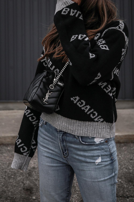 Nathalie Martin wearing Balenciaga black logo sweater, GRLFRND Denim Karolina jeans from Revolve, Saint Laurent LouLou small bowling bag, Alexander Wang Lyndon combat boots, Rag & Bone reversible wool coat, street style, woahstyle.com_4658.jpg