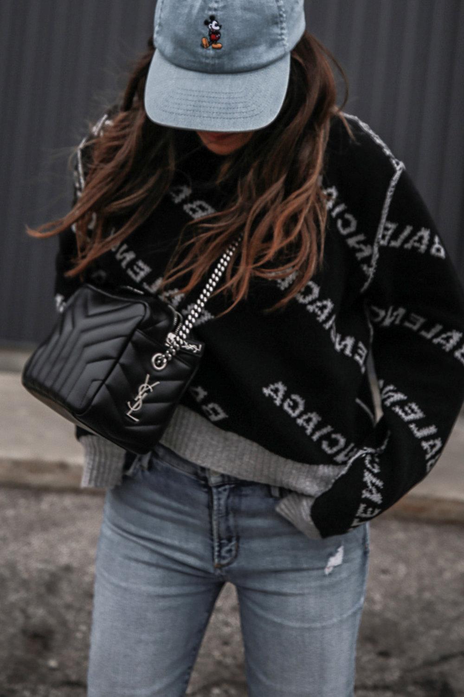 Nathalie Martin wearing Balenciaga black logo sweater, GRLFRND Denim Karolina jeans from Revolve, Saint Laurent LouLou small bowling bag, Alexander Wang Lyndon combat boots, Rag & Bone reversible wool coat, street style, woahstyle.com_4655.jpg