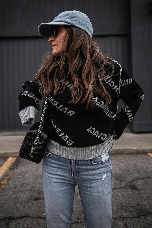 Nathalie Martin wearing Balenciaga black logo sweater, GRLFRND Denim Karolina jeans from Revolve, Saint Laurent LouLou small bowling bag, Alexander Wang Lyndon combat boots, Rag & Bone reversible wool coat, street style, woahstyle.com_4672.jpg