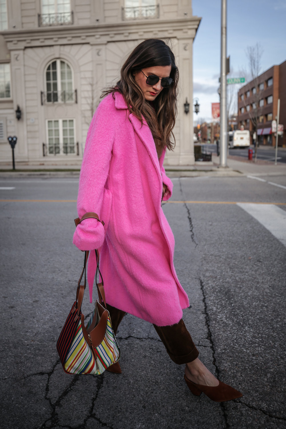 Nathalie Martin wearing Helmut Lang pink belt tie wool coat, brown corduroy pants, Zara brown textured sweater, Prada brown suede mules, Loewe striped Hammock bag, Bonlook Class sunglasses, street style, woahstyle.com_5151.jpg