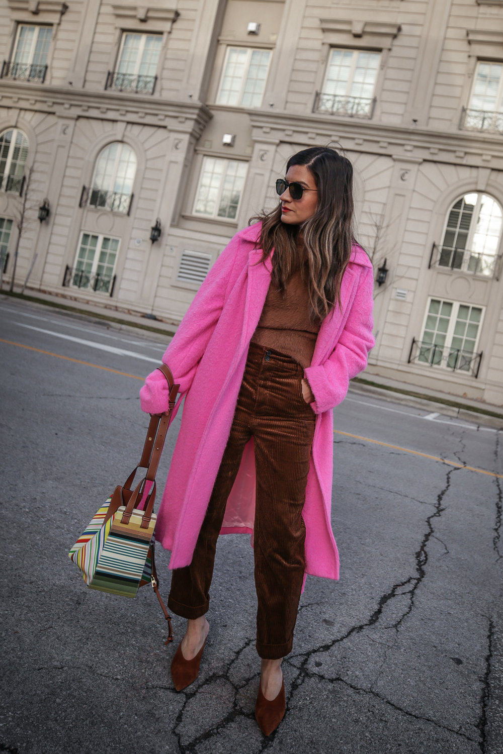 Nathalie Martin wearing Helmut Lang pink belt tie wool coat, brown corduroy pants, Zara brown textured sweater, Prada brown suede mules, Loewe striped Hammock bag, Bonlook Class sunglasses, street style, woahstyle.com_5150.jpg