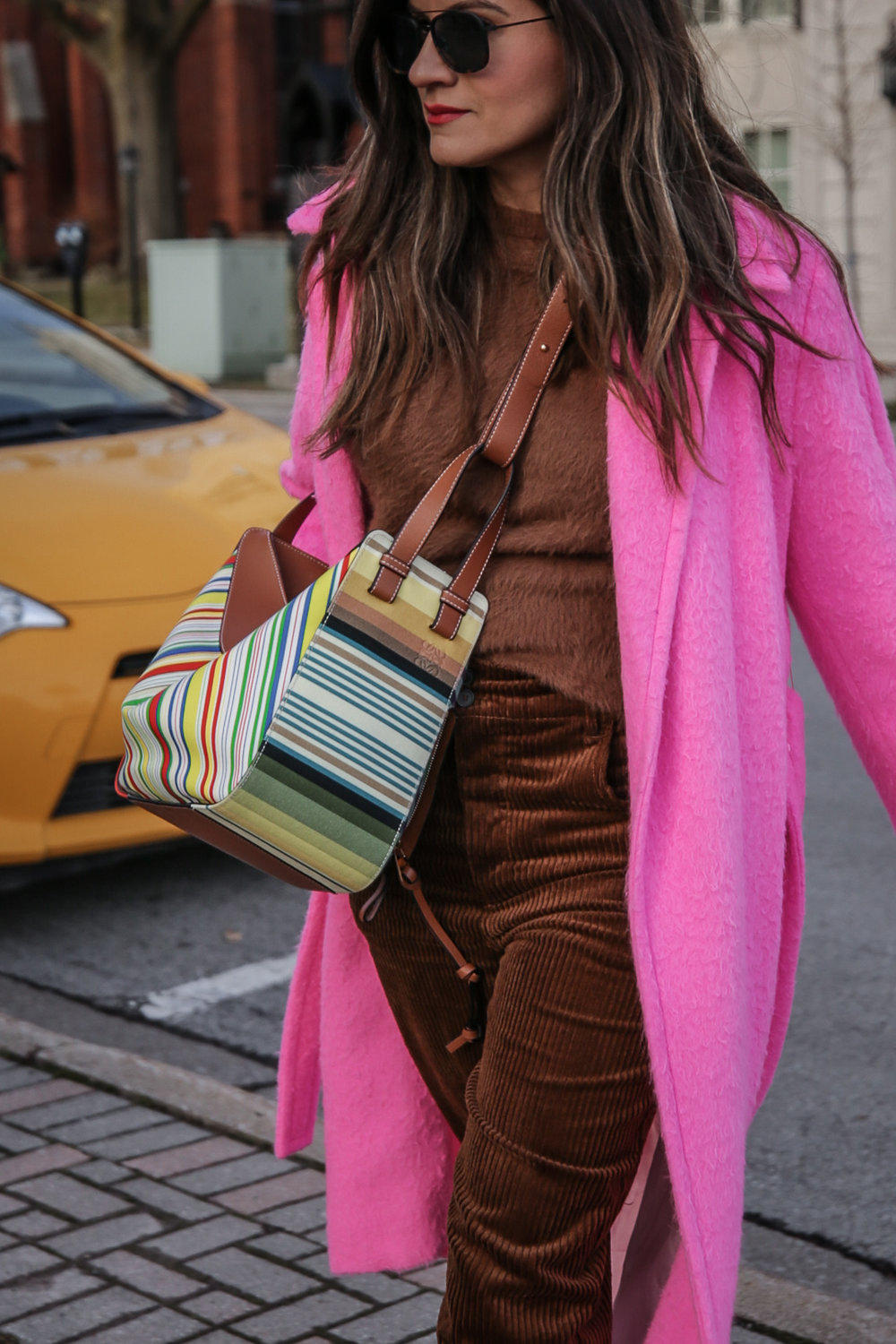 Nathalie Martin wearing Helmut Lang pink belt tie wool coat, brown corduroy pants, Zara brown textured sweater, Prada brown suede mules, Loewe striped Hammock bag, Bonlook Class sunglasses, street style, woahstyle.com_5172.jpg