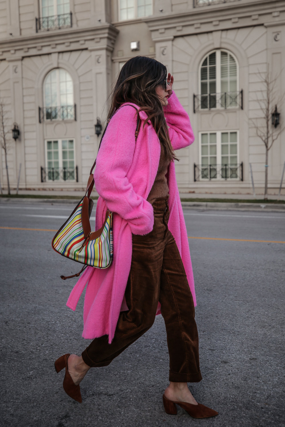 Nathalie Martin wearing Helmut Lang pink belt tie wool coat, brown corduroy pants, Zara brown textured sweater, Prada brown suede mules, Loewe striped Hammock bag, Bonlook Class sunglasses, street style, woahstyle.com_5195.jpg