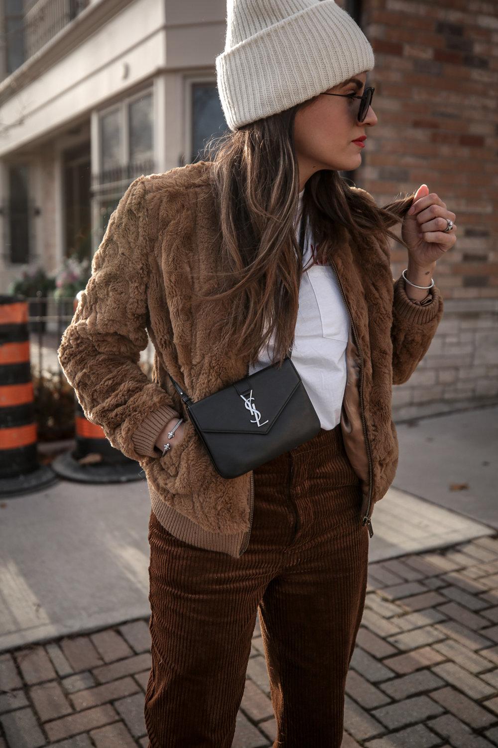 Nathalie Martin wearing brown teddy bear bomber jacket, corduroy pants, Sandro LOVE t-shirt, white sneakers, Saint Laurent Paris black bag, ivory Acne Studios Pansy face beanie, street style, Luka Sabbat inspired, woahstyle.com_4970.jpg