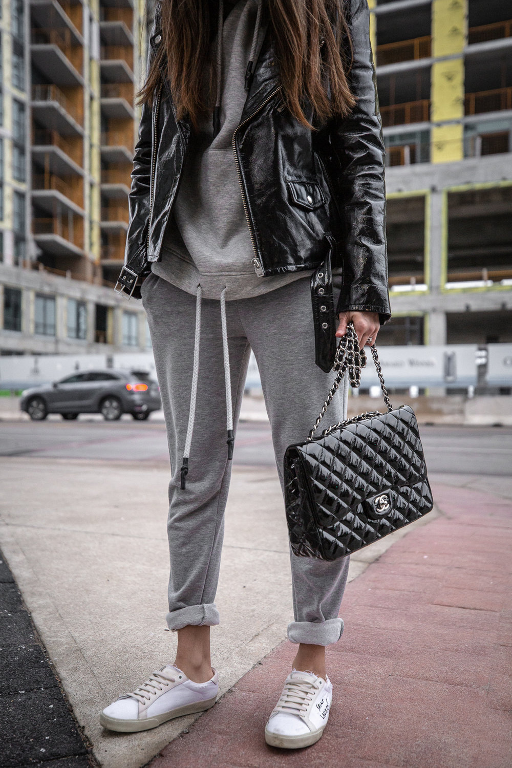Nathalie Martin - IRO Paris patent leather moto jacket, Zara sweatsuit, grey hoodie and sweatpants, Saint Laurent white canvas logo sneakers, CHANEL patent leather jumbo flap quilted bag, ACNE studios Pansy face beanie hat - woahstyle.com_5592.jpg