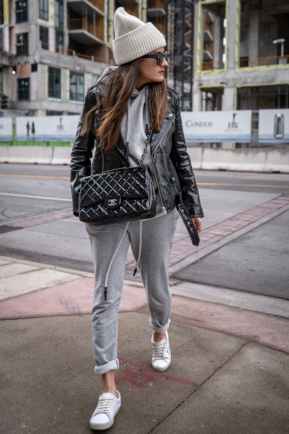 Nathalie Martin - IRO Paris patent leather moto jacket, Zara sweatsuit, grey hoodie and sweatpants, Saint Laurent white canvas logo sneakers, CHANEL patent leather jumbo flap quilted bag, ACNE studios Pansy face beanie hat - woahstyle.com_5527.jpg