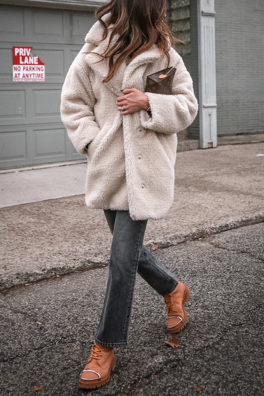 Nathalie Martin - Louis Vuitton Toiletry Pouch clutch 19, navy sweatshirt, Topshop teddy bear coat, Rag & Bone Hana cropped flared jeans, Alexander Wang Lyndon combat boots, casual street style, woahstyle.com_4862.jpg