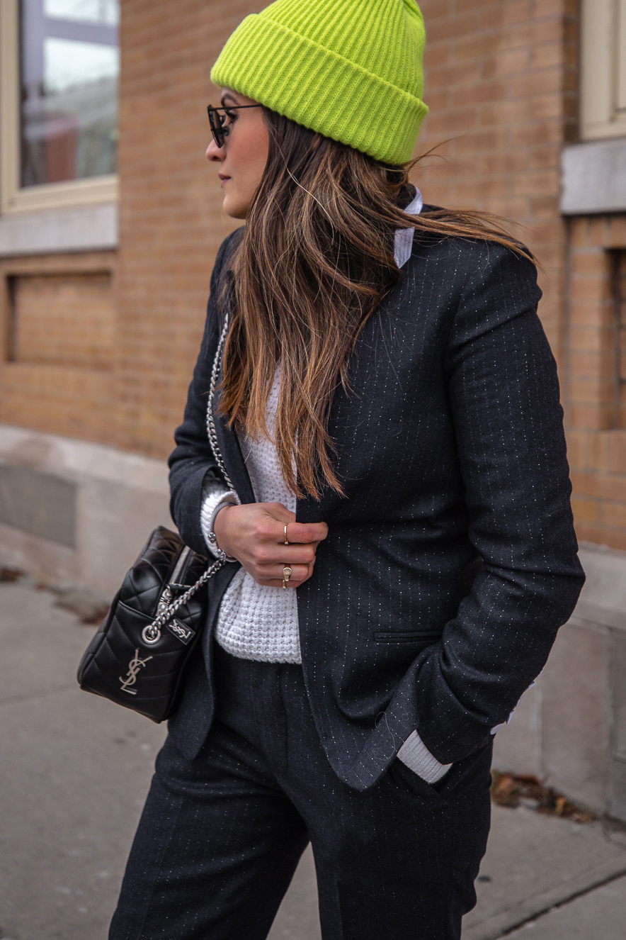 Nathalie Martin - Zadig & Voltaire pinstripe suit, Acne Studios white knitted sweater, Neon green beanie, Saint Laurent LouLou bowling bag and white canvas sneakers, Aritzia Stedman coat, street style, woahstyle.com_5937.jpg