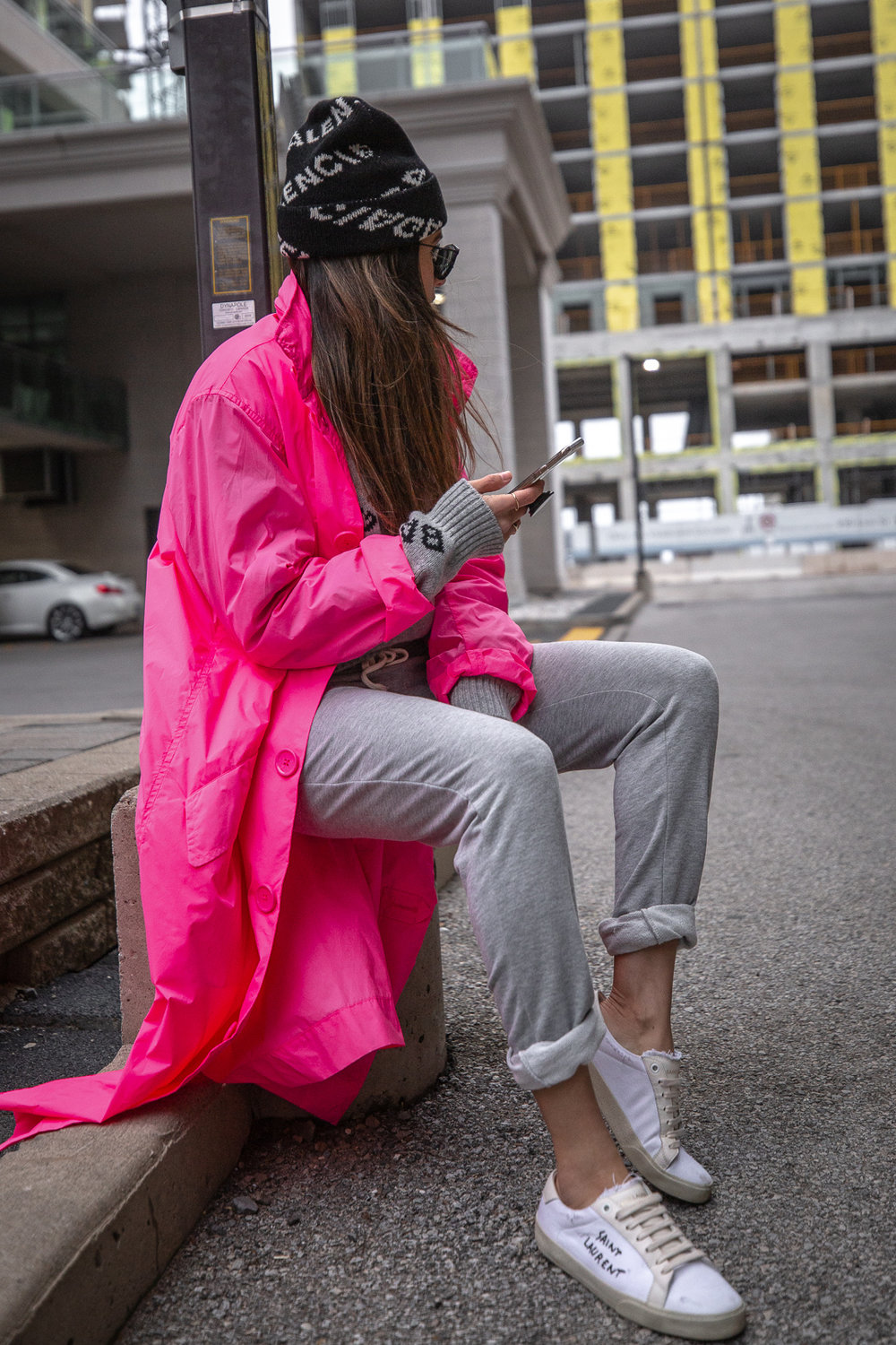Nathalie Martin - Opening Ceremony pink nylon trench, Saint Laurent white canvas sneakers, Balenciaga logo beanie and cropped logo sweater, grey joggers, casual street style, woahstyle.com_5515.jpg