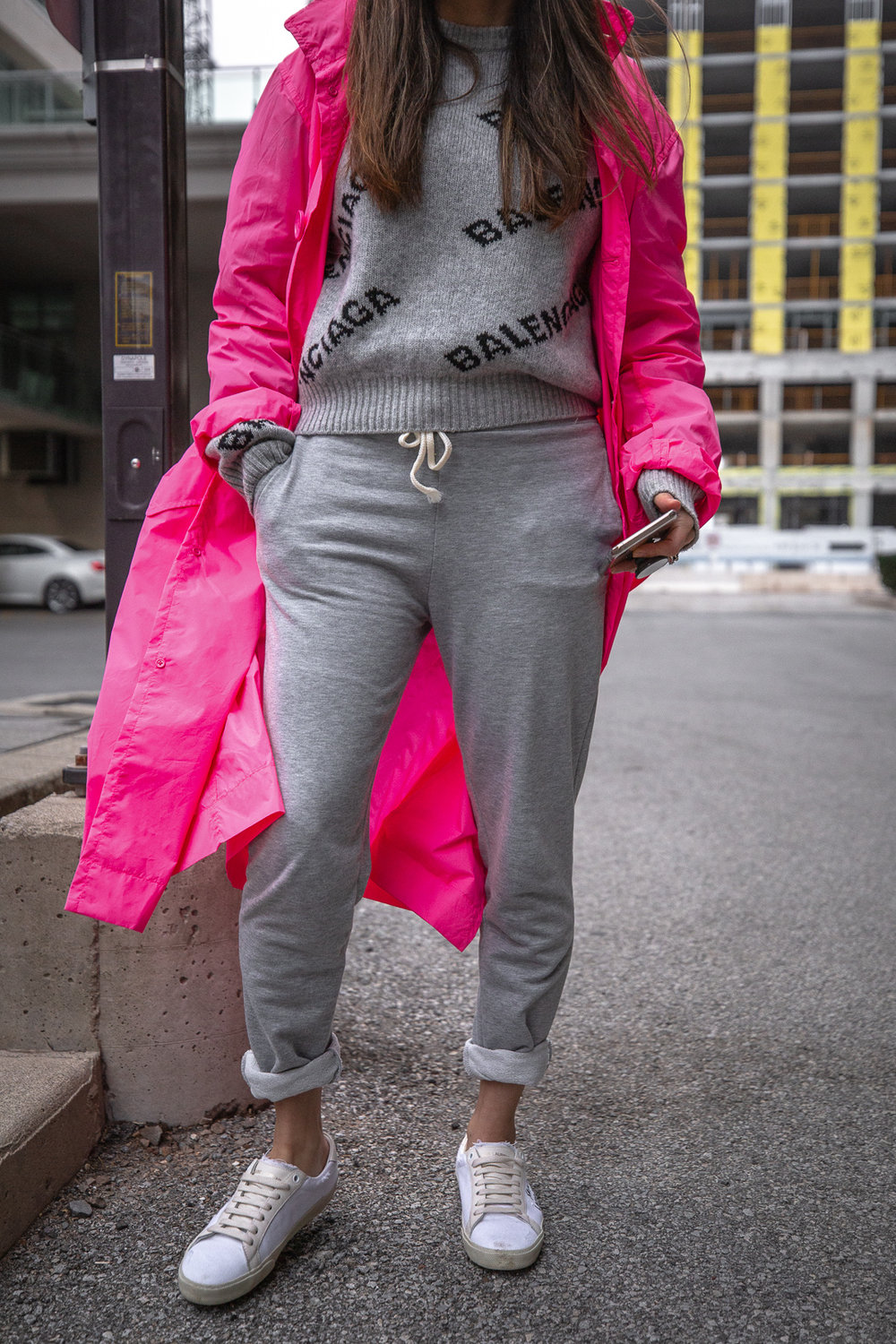 Nathalie Martin - Opening Ceremony pink nylon trench, Saint Laurent white canvas sneakers, Balenciaga logo beanie and cropped logo sweater, grey joggers, casual street style, woahstyle.com_5522.jpg