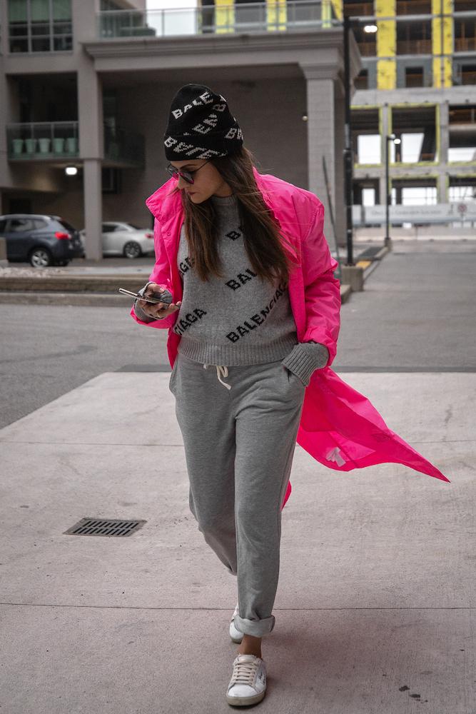 nathalie martin-grey balenciaga logo sweater and black beanie-grey jogging pants-white saint laurent sneakers-pink nylon opening ceremony coat-stree style-woahstyle.com.jpg