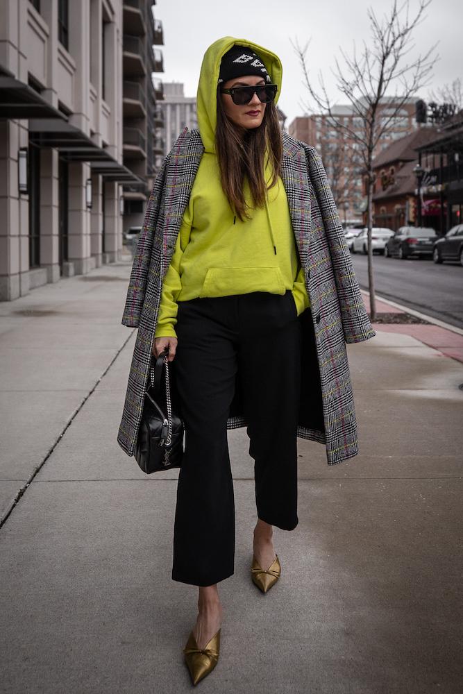 nathalie martin-neon yellow hoodie-plaid coat-saint laurent loulou bowling bag-bronze balenciaga knife mules and black logo beanie-street style-woahstyle.com.jpg