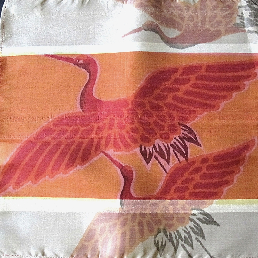 The Crane or Tsuru often appearing in Japanese textiles is a symb  ol of good fortune and longevity due to it's fabled life span of a thousand years.