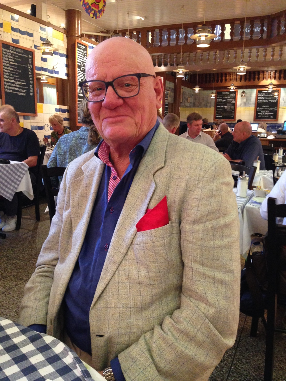 Elegantly dressed gentleman whom we had the pleasure of sharing a table with at the   Östermalms Saluhall (local Food Market).