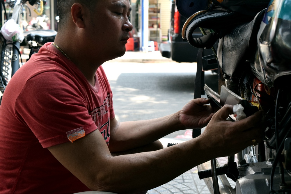 Mechanic in Saigon with deft hands