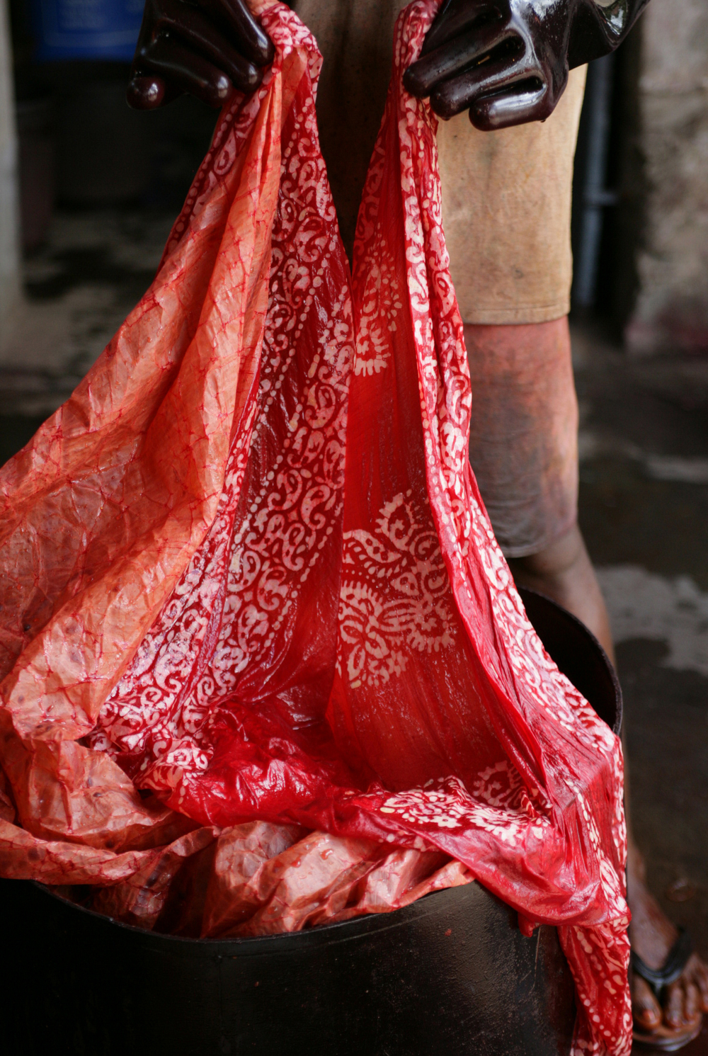 Red dye. Batik dyeing in India. Indigo Handloom.