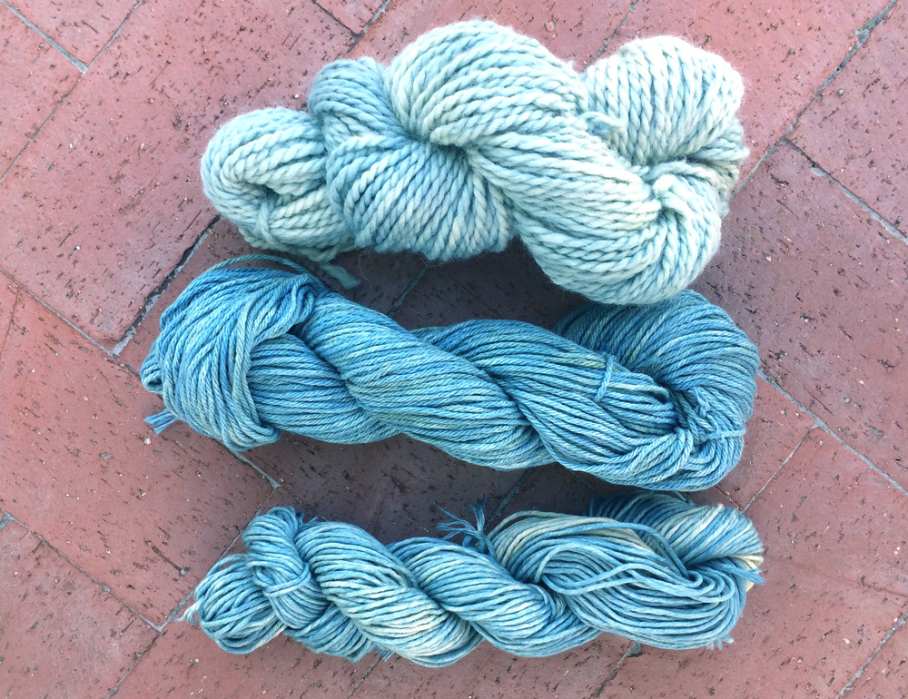 Oak gall and indigo dye on two different types of cotton and one baby alpaca yarn. Image courtesy of Liz Spencer.