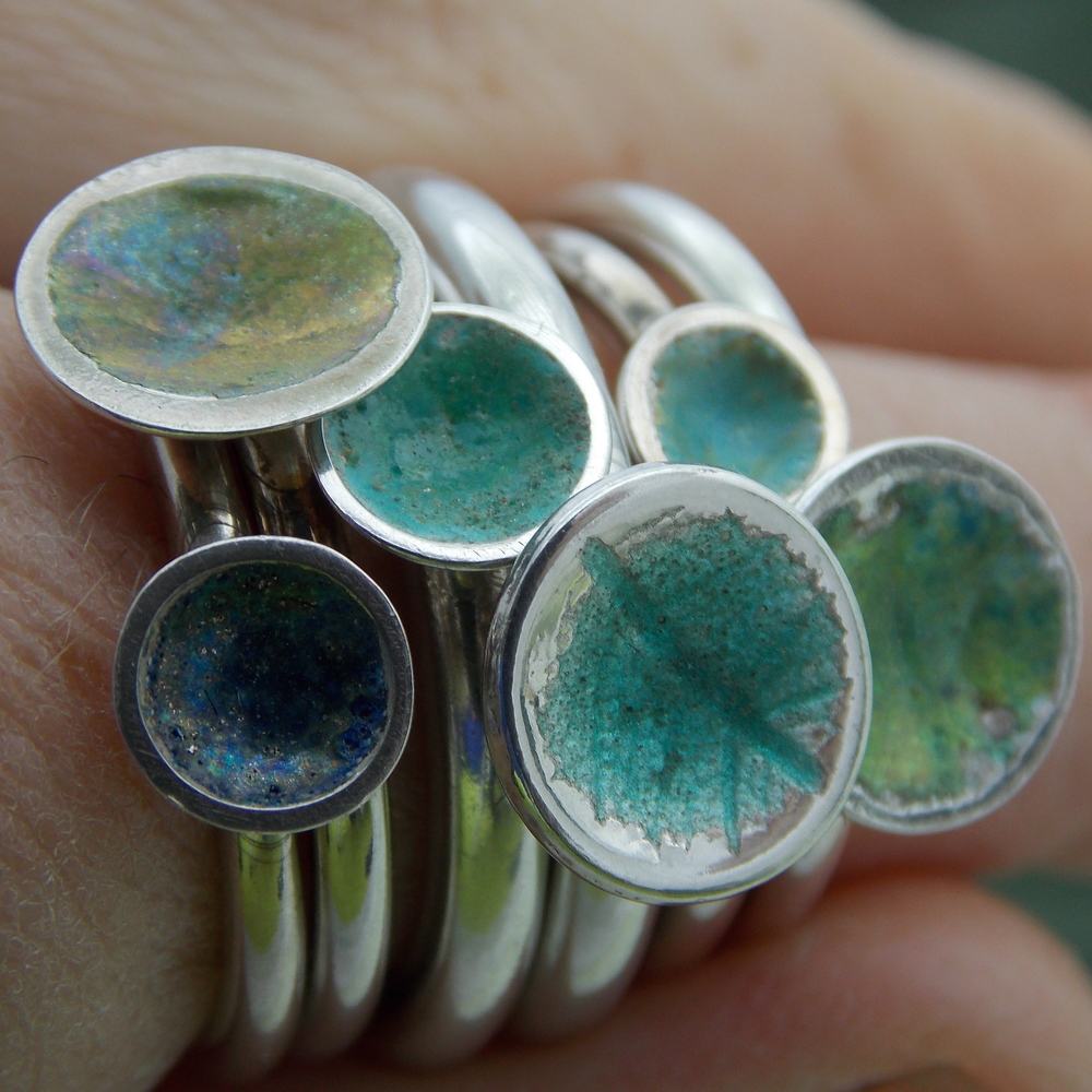 make a collection of stackable Enamel rings experimenting with different mixes of fine  glass granules. create iridescent hues with a firing of fine metal dust