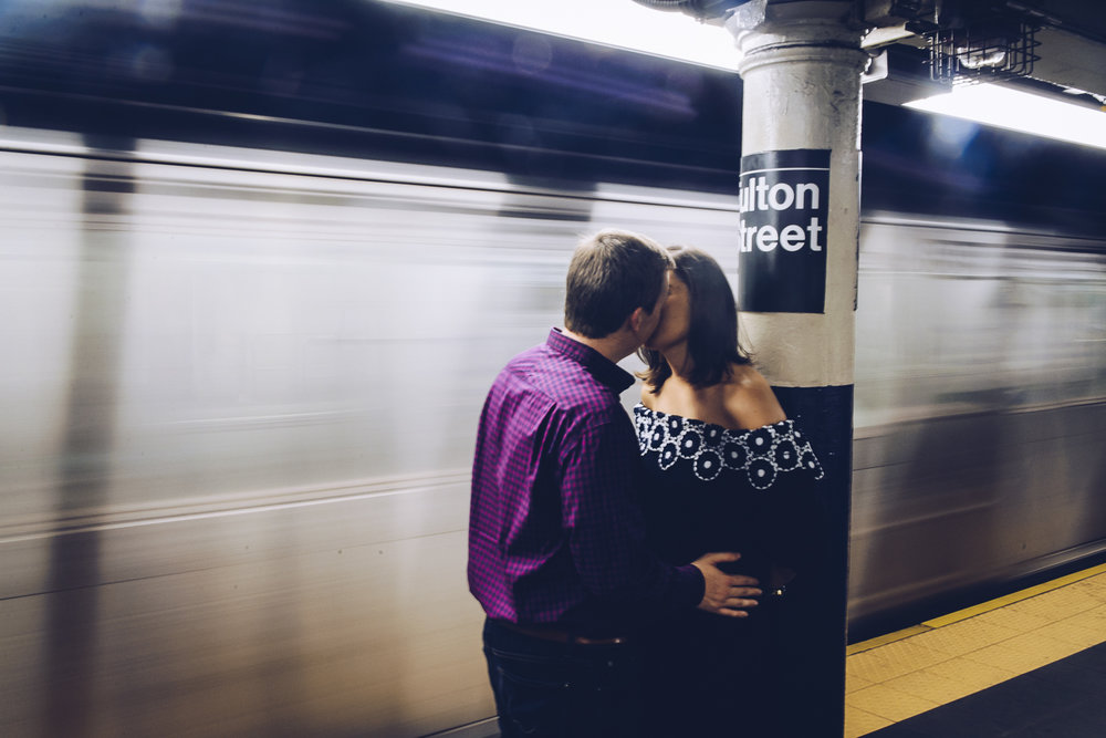 Christine & Jim Engagement session by Unveiled Weddings in Fulton St. NYC.