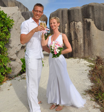 """The dress was stunning - perfect for our wonderful wedding day in the Seychelles.""  - Mikki and Anita Sapperton"