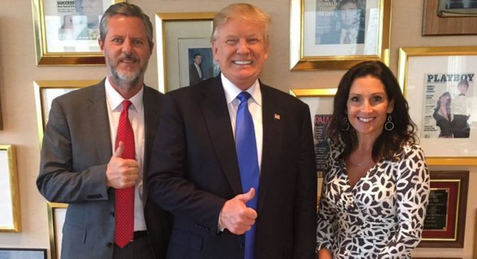 Jerry Falwell, Jr. with Trump.....right next to framed Playboy issue featuring Donald himself...