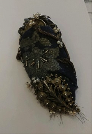 One of Diane's scrap & found object pins