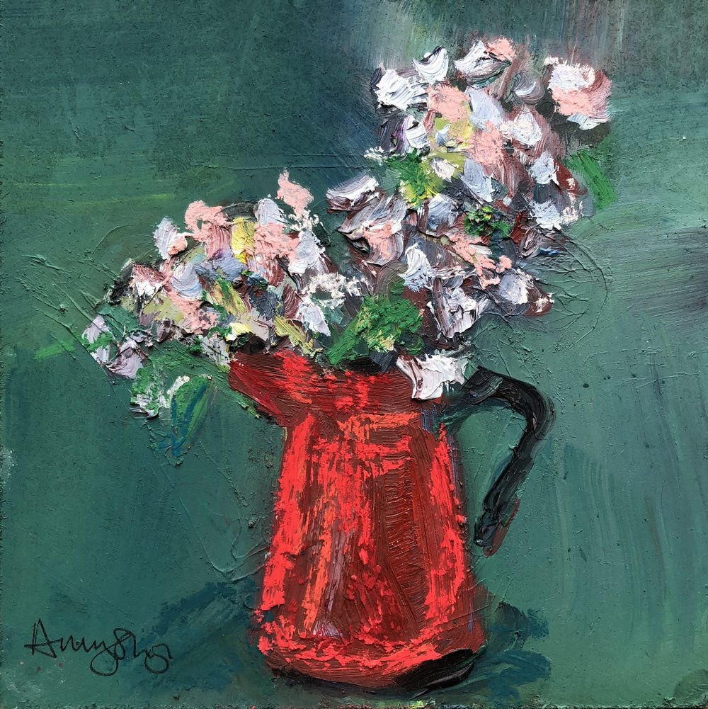Sweetpeas in red jug