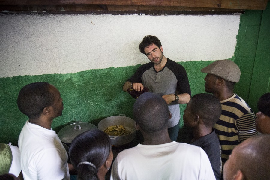 Demonstrating how to cook traditional Haitian curry; Photo by Crystal Wells