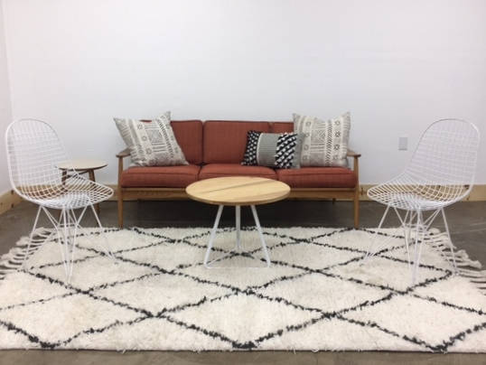 Karlson Lounge 2: $555 We love a simple modern lounge! This one has lots of white with Karlson, our rust colored mid-century daybed as the focal point!