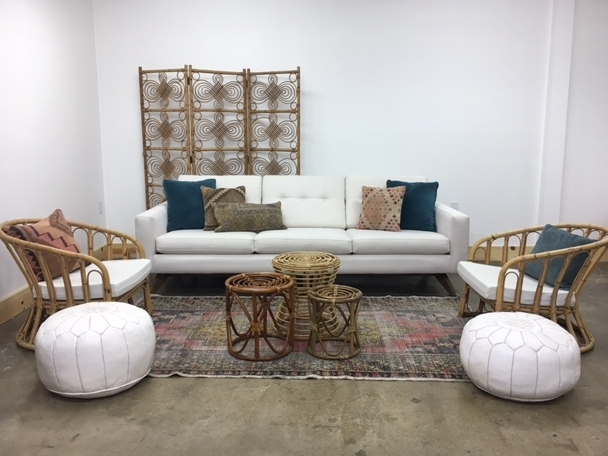 Merick Lounge 3: $815   Calling all bohemian lovers! Lots of rattan and white with neutral kilim pillows and pops of teal. And that room divider to add a bit of height and character!