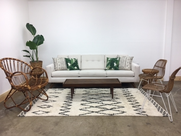 Merick Lounge 1: $760 For those wanting a modern, bohemian, tropical lounge! The Merick couch brings the modern while the rattan and palm leaves add the perfect touch of tropical bohemian!