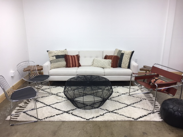 Merick Lounge 4: $890   Edgy and modern with black and silver, this lounge is for the modern lover. Mostly black and white with pops of rust to warm things up!