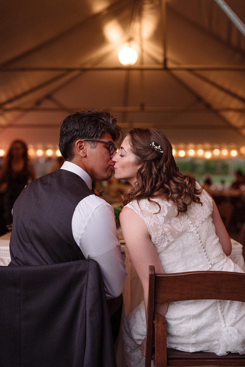 Kaitlyn+Harley- Raritan Inn Wedding- Bride and Groom Kissing Backs of Chairs- Olivia Christina Photo.JPG