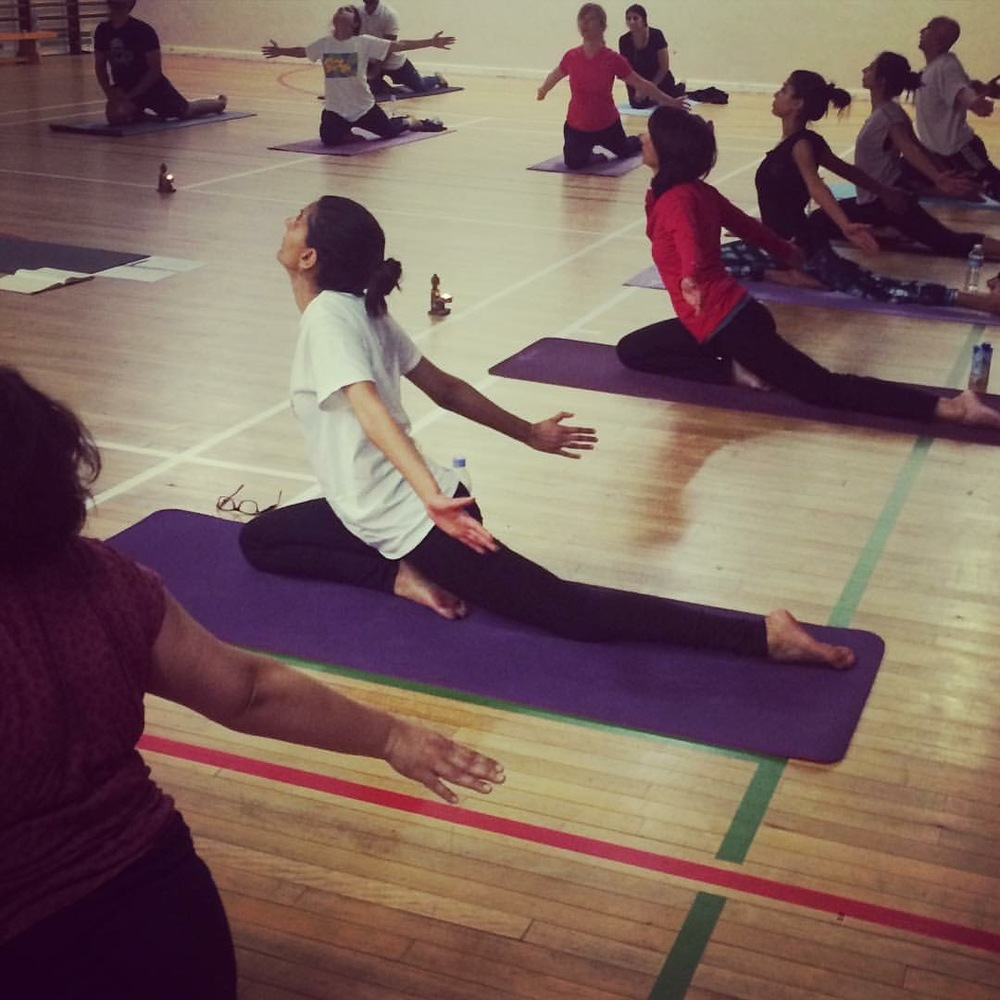 Weekly class students in Hatch End enjoying PIGEON POSE!