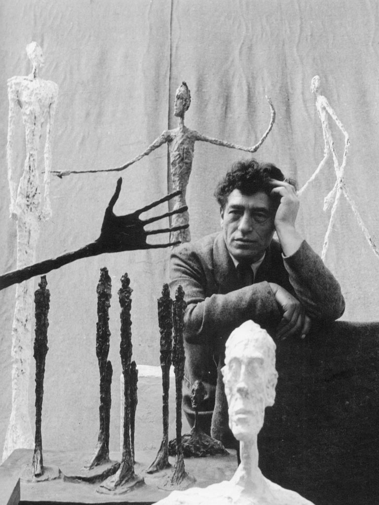 Alberto Giacometti with some of his sculptures