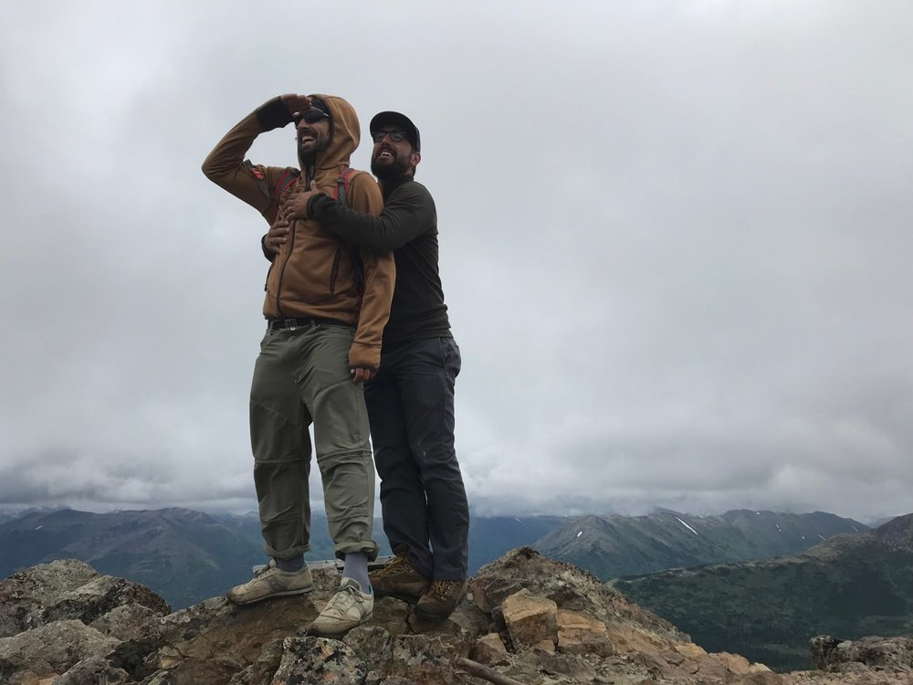 My brother and I share a joyous embrace on the summit.