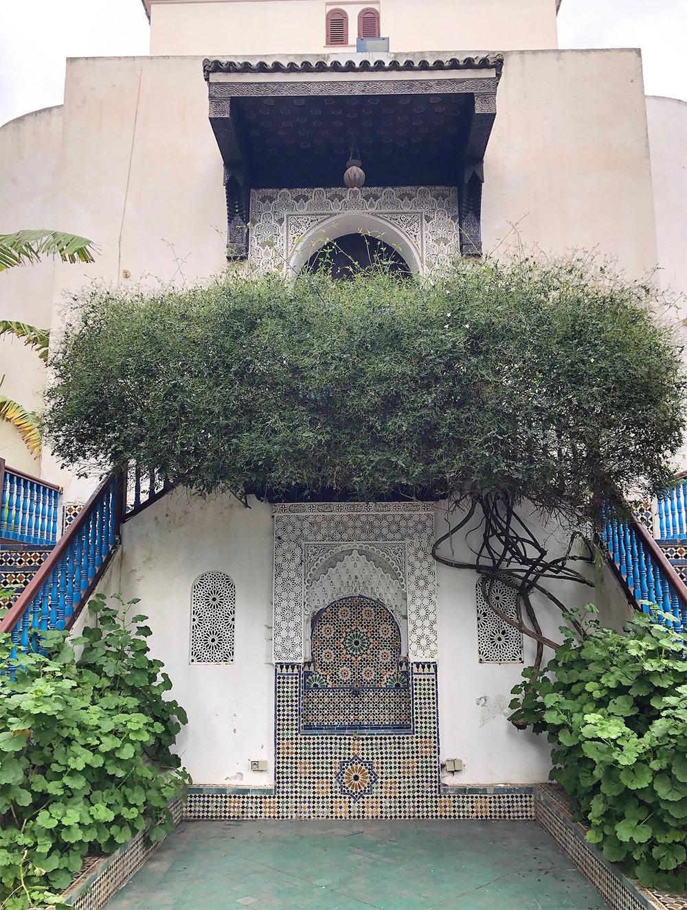 A beautiful tiled fountain in the courtyard of the Royal Artisan School in Tetouan, Morocco
