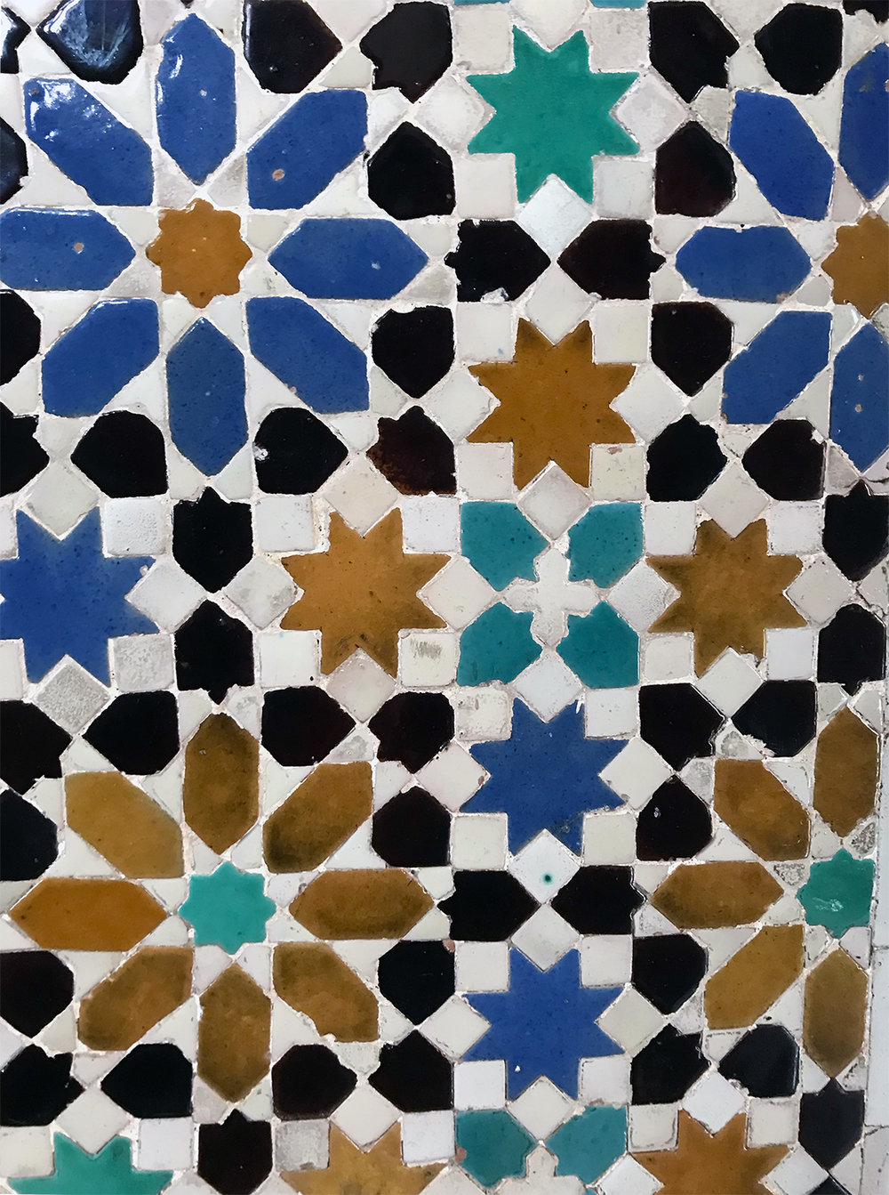 The colors and shapes were mesmerizing.  Each piece is cut by hand and pieced together by a tiler.
