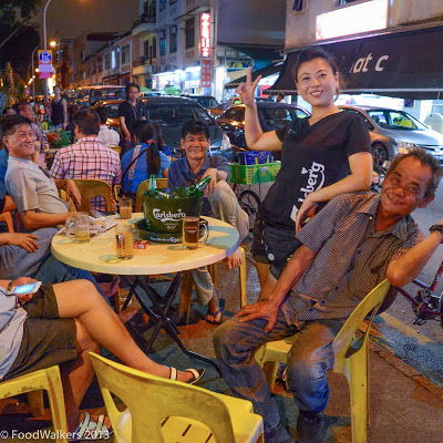 A beer girl and her boys in late night Geylang..